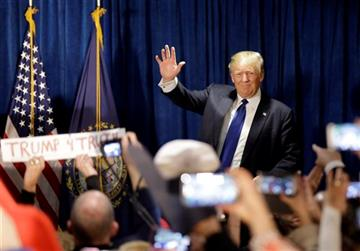 Republican presidential candidate, businessman Donald Trump takes the stage to speak to supporters during a primary night rally, Tuesday, Feb. 9, 2016, in Manchester, N.H.